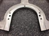 A bottom half view of a 304 stainless machined spindle plate