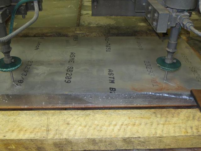 Drills cut into aluminum fixture