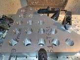 Aluminum fixture waits for the next step in assembly