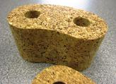 A close up view at a piece of cork that has been waterjet cut