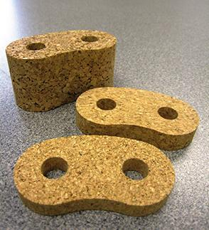 Three pieces of cork that have been waterjet cut
