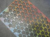 Overhead view of a multi-color custom perforated plate