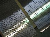 Overhead view of two custom perforated plates