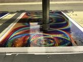 A high pressure waterjet prepareds to work on a holographic sheet