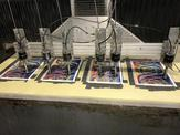Multiple holographic sheets being worked on by high pressure waterjets