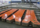 Large plats lay ready for the waterjet cutting process