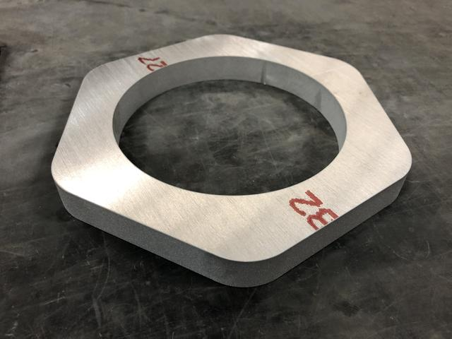 Fresh off the waterjet, ready for the deburring process