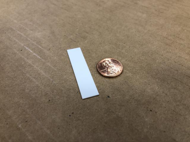 Comparison of finished piece next to a Penny