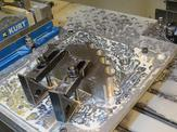 An overhead view of FedTech's load block going through the waterjetting process