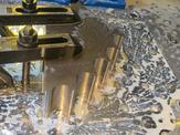 A close up view of FedTech's load block getting its profile parts waterjetted
