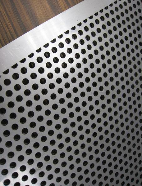 A close up view of a custom perforated plate