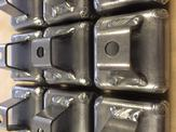 An up close view of multiple 16GA carbon steel mounting brackets