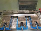 Upper link parts are started with waterjet cut blanks