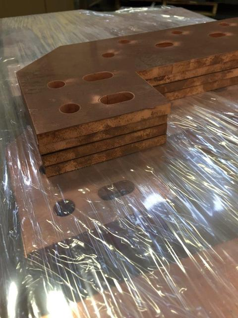 Waterjet copper plates stacked on top of each other